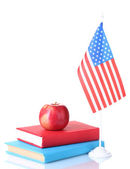 Composition of the American flag, a pair of books and apple isolated on whi — Stock Photo