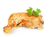 Roasted chicken leg with parsley isolated on white — Stock Photo