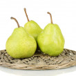 Ripe pears on wicker mat isolated on white — Stock Photo #13210073