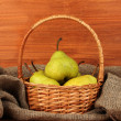 Ripe pears in sack on wooden background close-up — Stock Photo #13210084