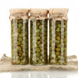 Glass jar with tinned capers isolated on white — Stock Photo #13210099