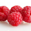 Ripe raspberries isolated on white - Stock Photo