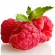 Ripe raspberries with mint  isolated on white - 图库照片