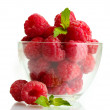 Ripe raspberries with mint in glass bowl isolated on white - Stockfoto