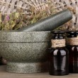 Thyme herb and mortar on wooden table on brown background - Lizenzfreies Foto