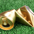Crumpled empty can on grass — Stock Photo #13210761