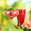 Refreshing desserts of watermelon on green background close-up - Stock Photo