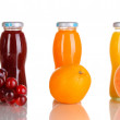 Delicious grapes, orange and apple juice in glass bottle and fruit next to — Stock Photo