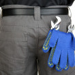 Gloves and instruments in back pocket close-up - Stockfoto