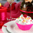 A delicious creamy dessert on celebratory table of Valentine's Day on room  — Stock Photo