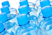 Plastic bottles of water close-up — Stock Photo