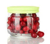 Fresh cornel berries in glass jar isolated on white — Stockfoto