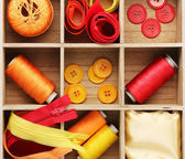 Material for sewing in wooden box closeup — 图库照片