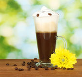 Glass of fresh coffee cocktail on green background — Stock Photo