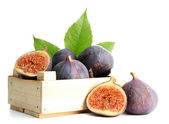 Ripe sweet figs with leaves in wooden crate isolated on white — Stock Photo