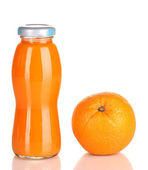 Delicious orange juice in a bottle and orange next to it isolated on white — Stock Photo