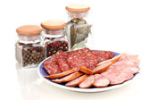 Tasty sliced sausage on plate isolated on white — Stock Photo
