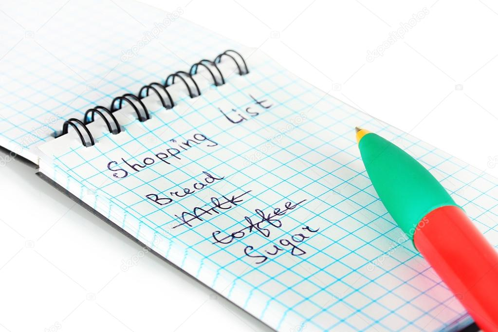 Shopping list in a notebook on white background close-up — Stock Photo #13212651