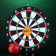 Stock Photo: Darts with sticker symbolizing health on colorful background