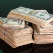 Royalty-Free Stock Photo: Stacks of dollars on green background