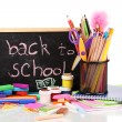 The words 'Back to School' written in chalk on the small school desk - Stock Photo