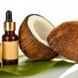 Постер, плакат: Coconut oil in bottles with coconuts on white background