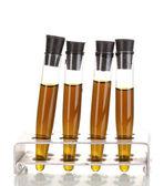 Tubos de ensayo con líquido marrón aislado en blanco — Foto de Stock
