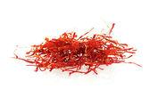 Stigmas of saffron isolated on white background — Stock Photo