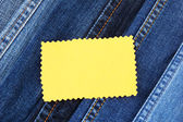 Many jeans with label closeup — Stock Photo