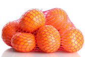 Ripe tangerines in bag isolated on white — Stock Photo