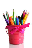 Colorful pencils and felt-tip pens in pink pail isolated on white — Stock Photo