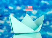 Ship with the American flag, on blue background. Columbus Day. — Stock Photo