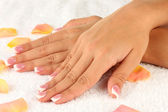 Woman's hands on white terry towel, close-up — Stock Photo
