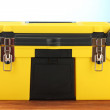 Yellow tool box on blue background close-up — 图库照片