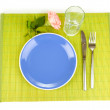 Table setting on a bamboo mat — Stock Photo #13351669