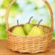 Ripe pears on colorful green background — Stock Photo #13351749