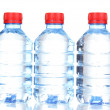 Plastic bottles of water isolated on white — Stock Photo #13351841