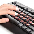 Painful typing on keyboard close-up — Stockfoto