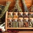 Dried herbs, spices and and pepper, on wooden background — Stock Photo #13352147