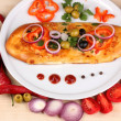 Delicious slice of pizza on plate with ingredients around close-up on woode — Stock Photo