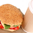 Stock Photo: Appetizing sandwich with coffee in disposable cup isolated on white