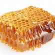 Sweet honeycomb with honey, isolated on white — Stock Photo