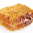 Sweet honeycomb with honey, isolated on white — Stock Photo #13359454