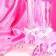 Wedding accessories on pink cloth background - Photo