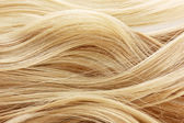 Curly blond hair background — Stock Photo