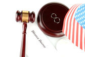 Divorce decree and wooden gavel on white background — Stock Photo