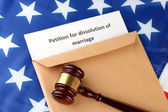 Divorce decree and envelope on american flag background — Stock Photo