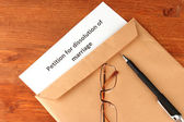 Divorce decree and envelope on wooden background — Stock Photo
