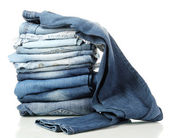 Lot of different blue jeans isolated on white — Foto de Stock