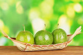 Green passion fruit on green background — Stock Photo
